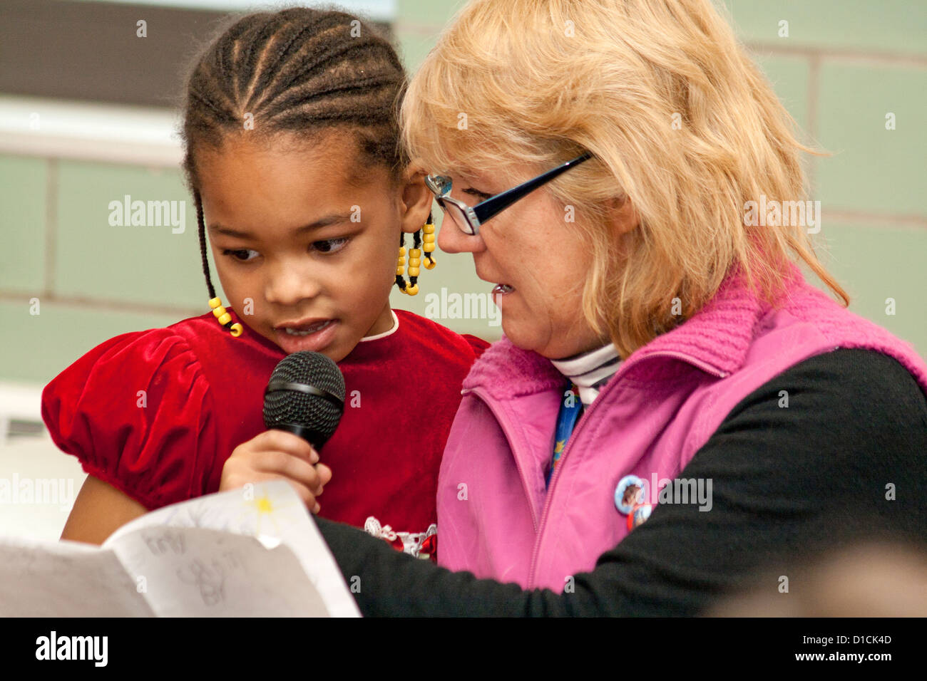 Teacher working on class presentation with black African American student age 5. Expo Elementary School St Paul Stock Photo