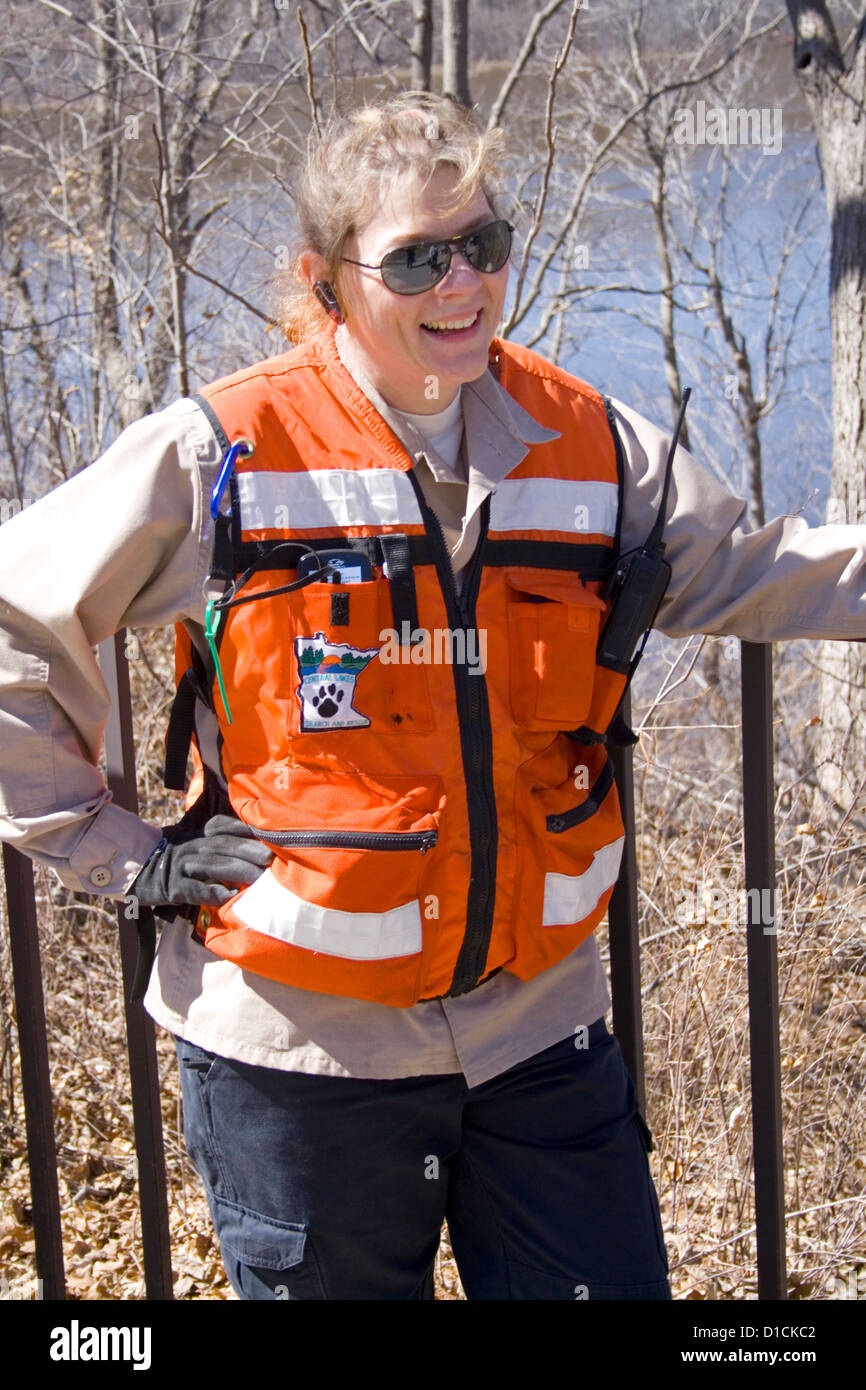 Search and Rescue Emergency Support Services woman taking a break from finding lost college student. St Paul Minnesota - Stock Image