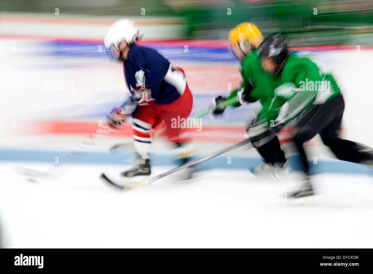 Blurred image of boys age 10 playing hockey. Braemar Hockey Arena Edina Minnesota MN USA - Stock Image