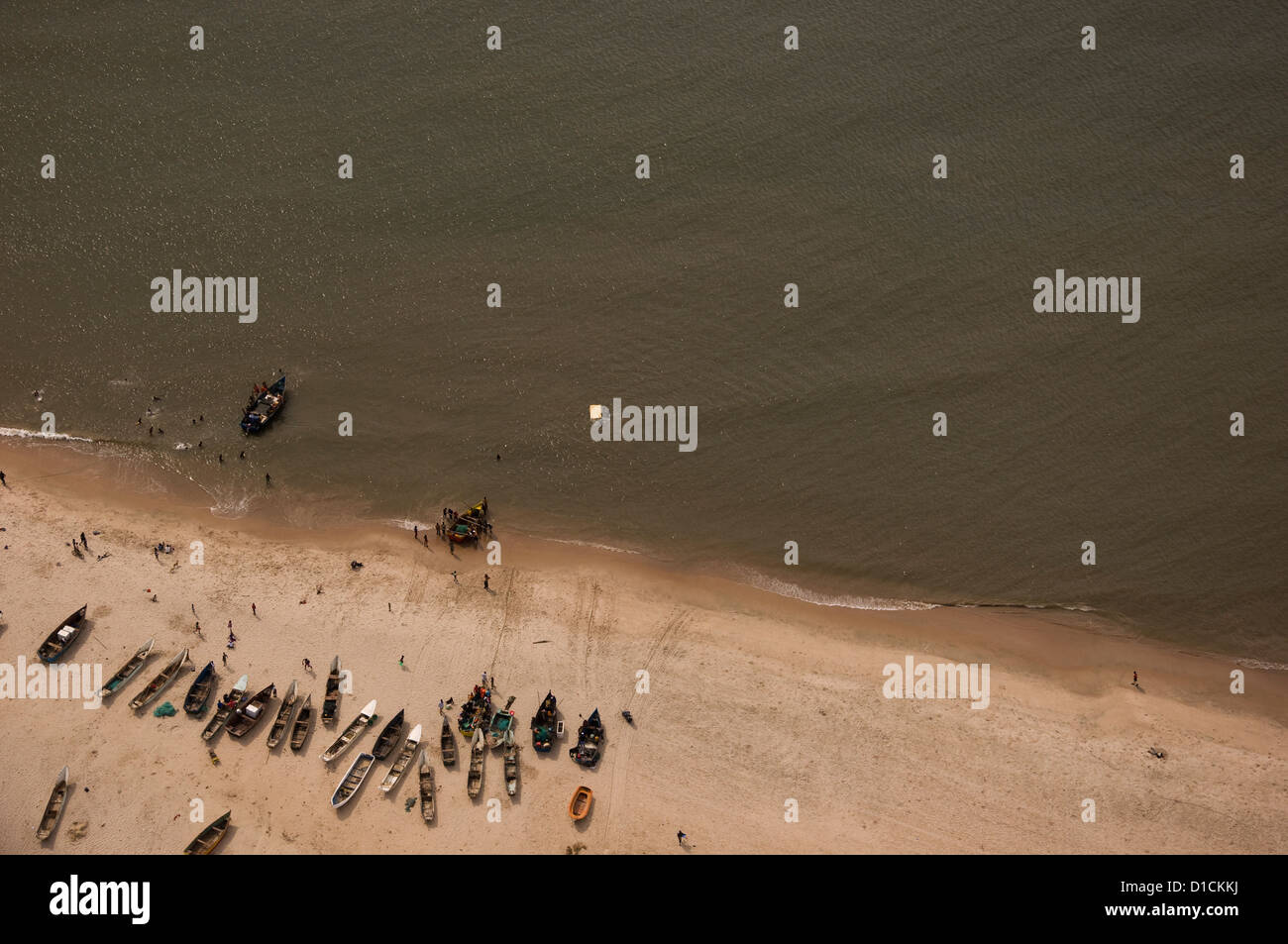 Aerial shot of a remote beach well north of Luanda  Angola bustling with activity. - Stock Image