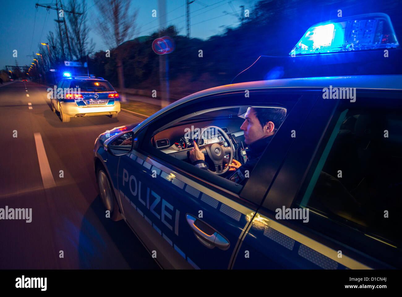 Police patrol car with blue flashing lights, signal horn