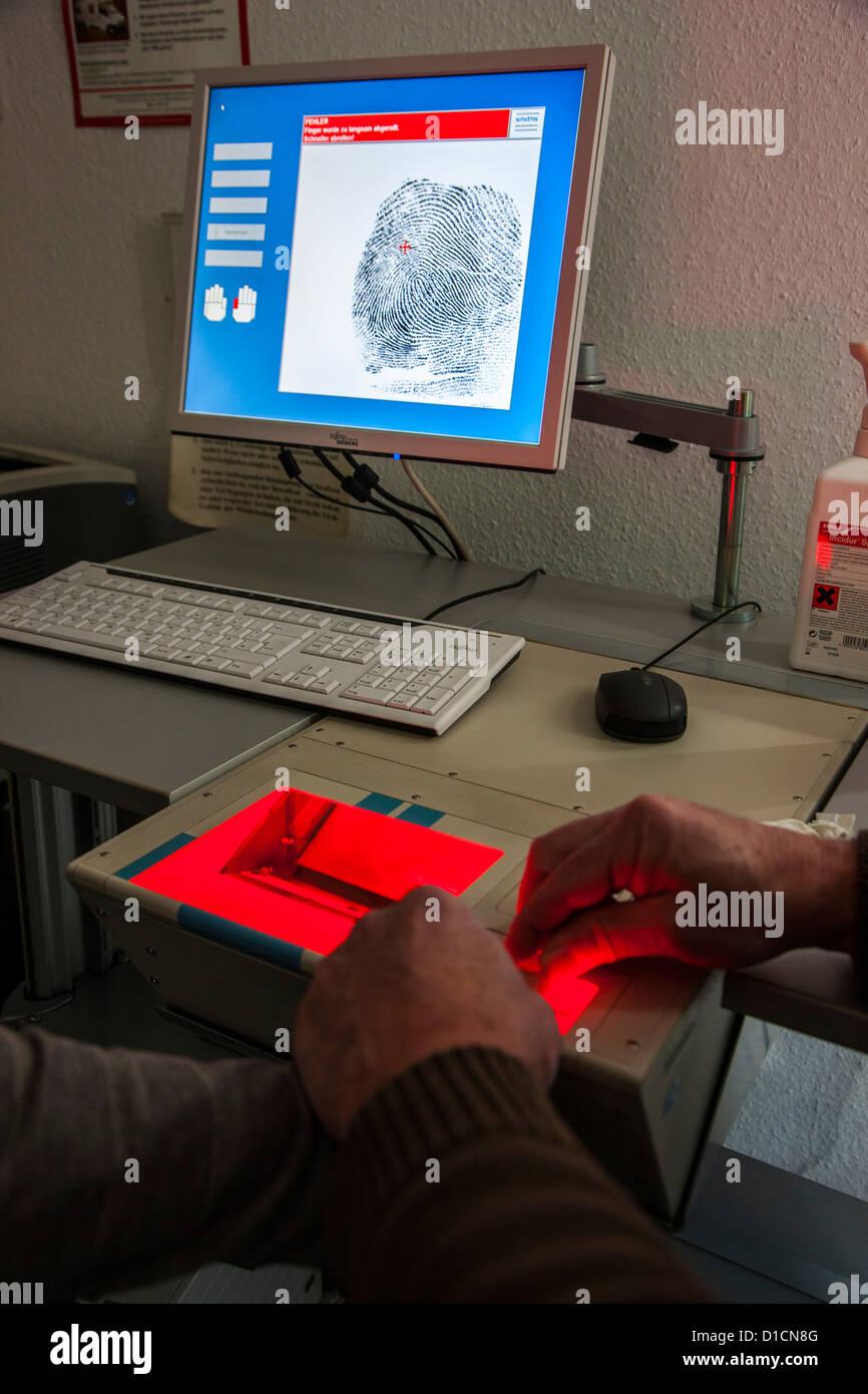 Police, taking fingerprints with a digital laser scanner. Stock Photo