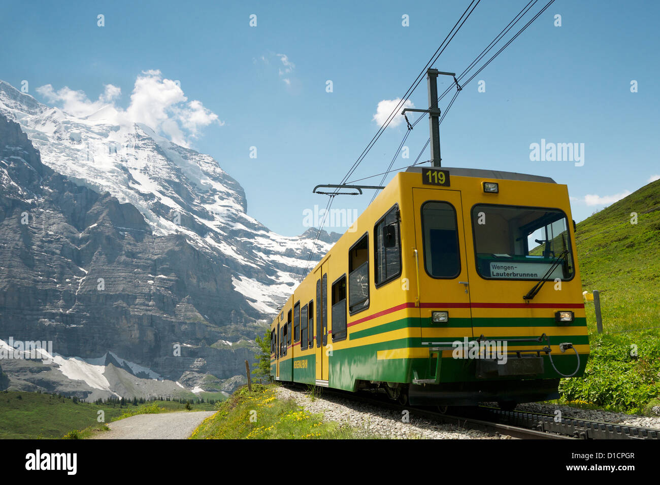 Yellow train Kleine Scheidegg  bernese oberland switzerland - Stock Image