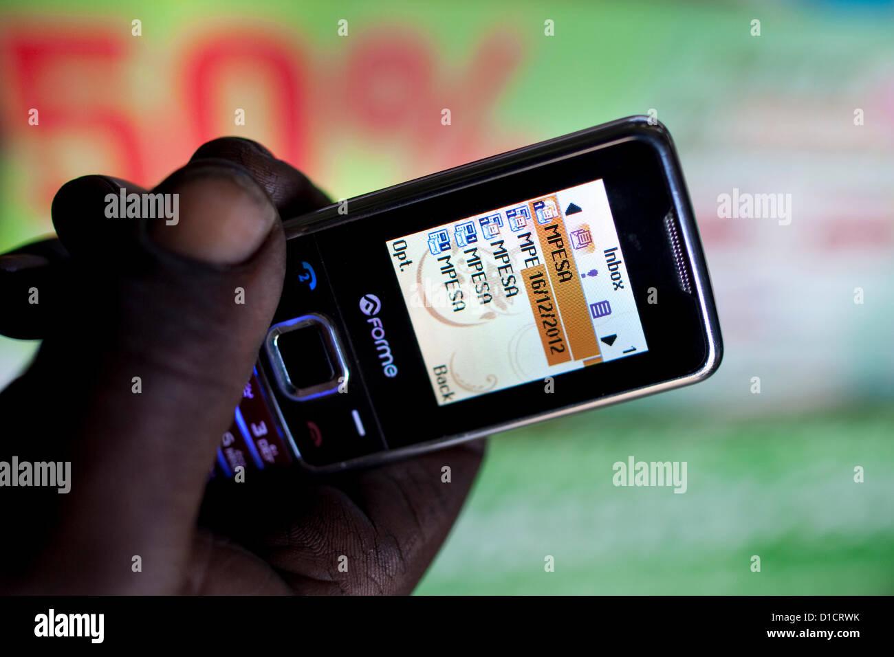 M-Pesa mobile-phone money transfer service in Kenya Stock Photo