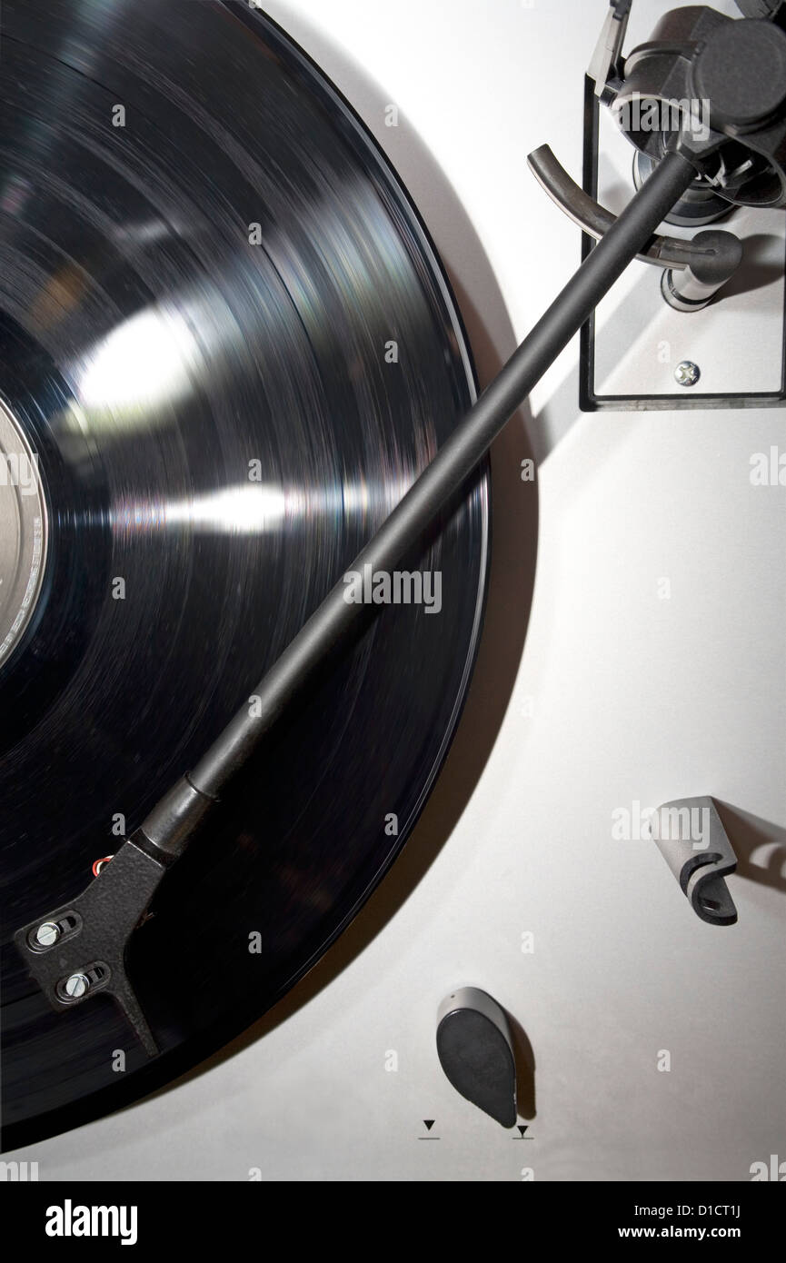 Turntable with an LP record in rotation blur. - Stock Image