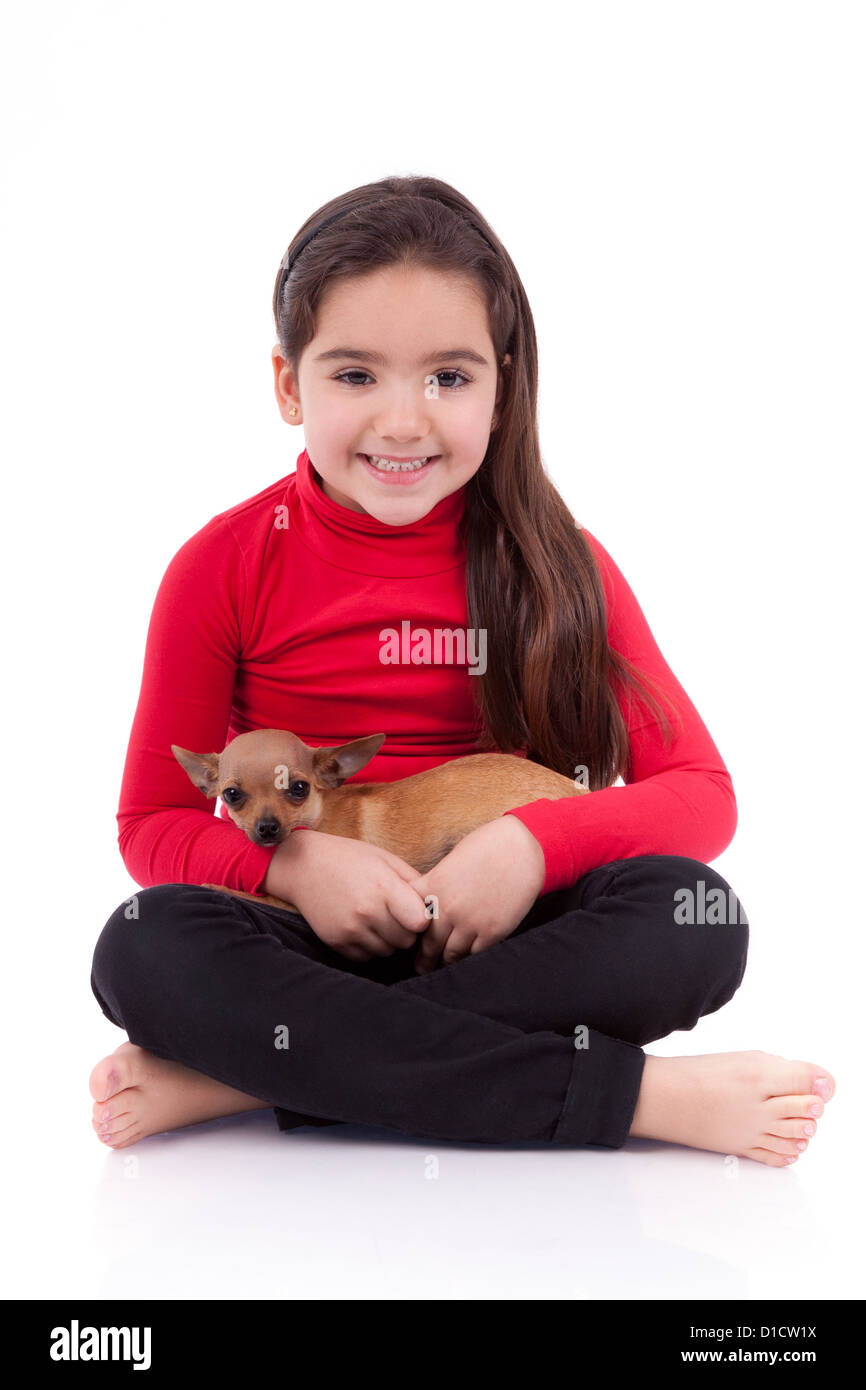 Little caucasian girl with her pet, isolated on white background - Stock Image