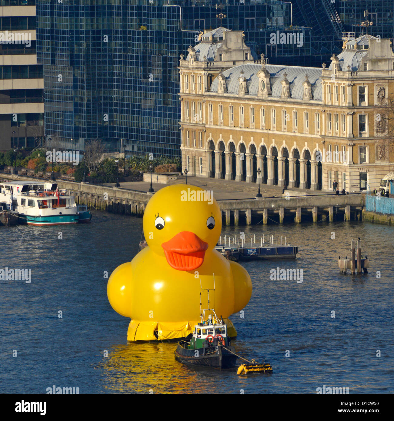 Yellow duck on River Thames promoting the Jackpotjoy bingo website, seen with the old Custom House building beyond - Stock Image