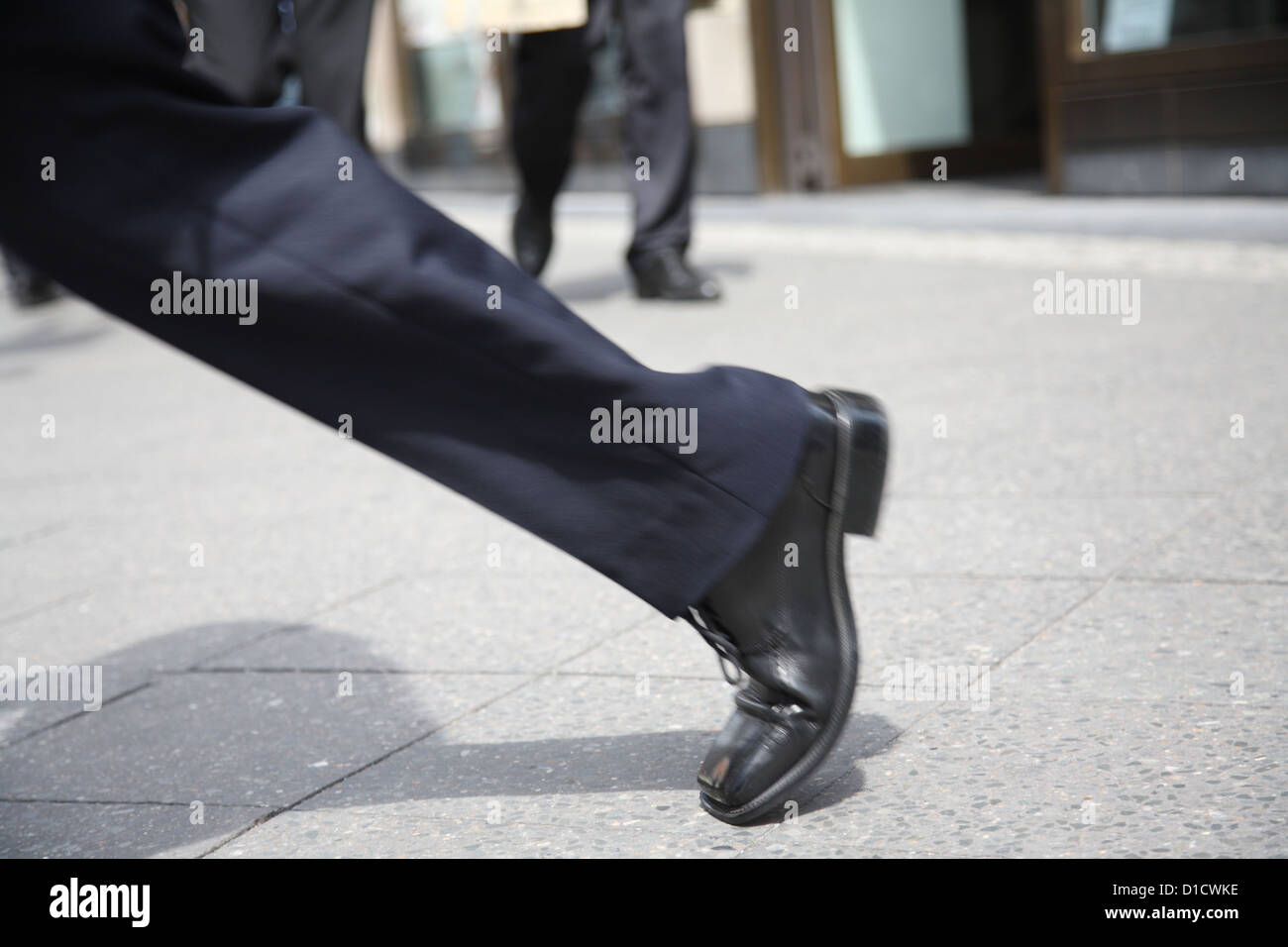 Berlin, Germany, leg of a passerby on the street - Stock Image