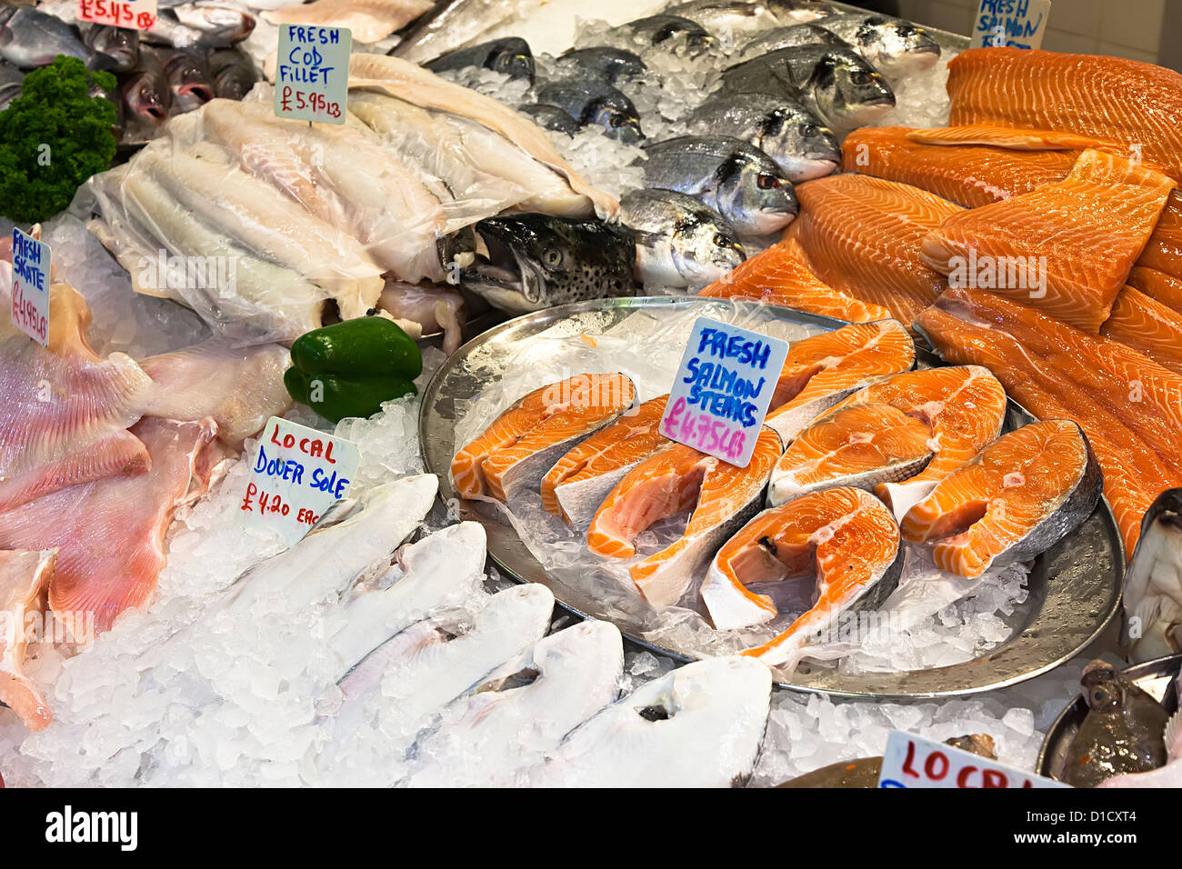 Fresh fish on sale on central market fishmonger stall, St Helier, Jersey, Channel Islands, UK - Stock Image