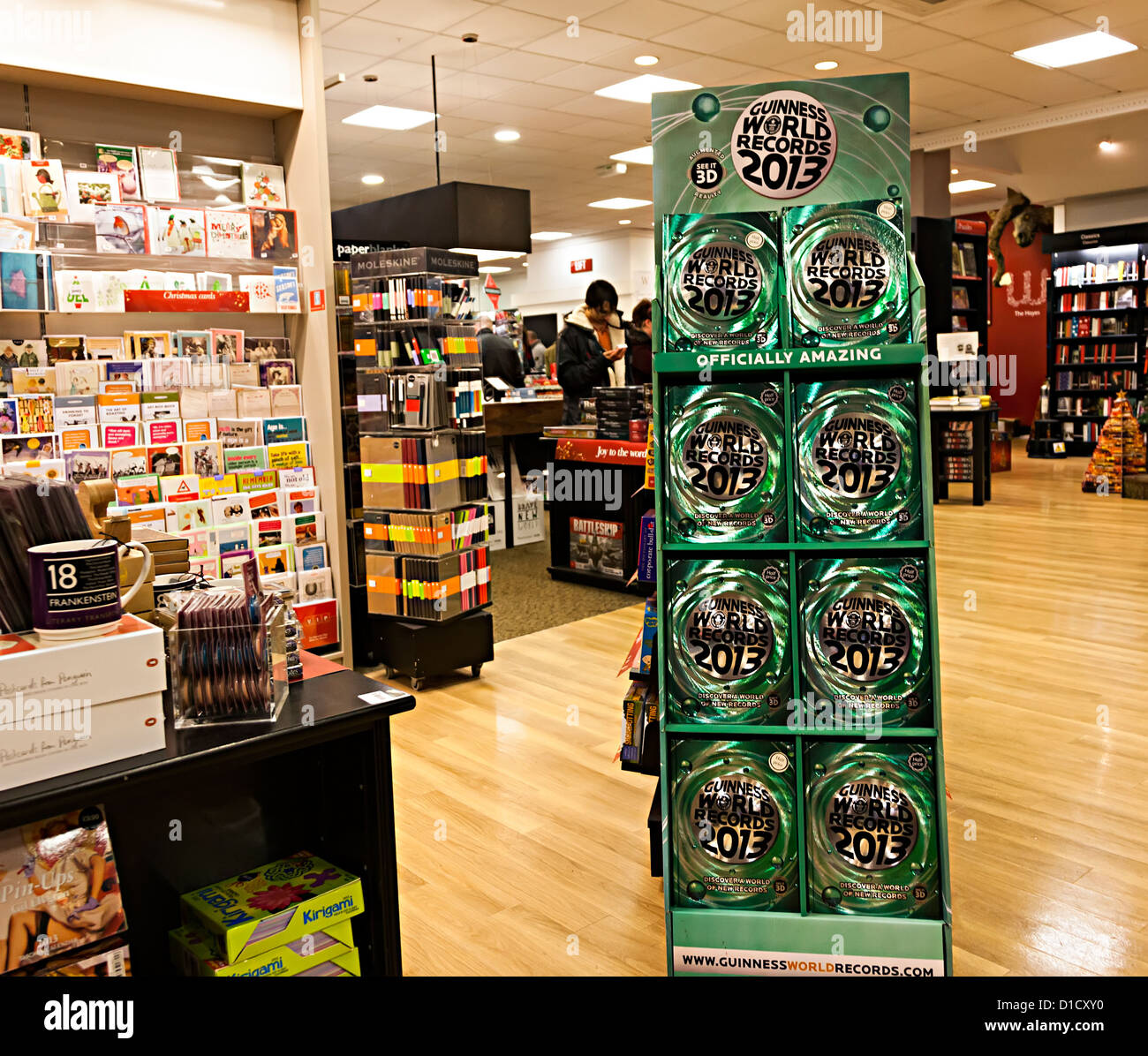 Guinness World Records 2013 book in stand on sale in shop, Cardiff, Wales, UK - Stock Image