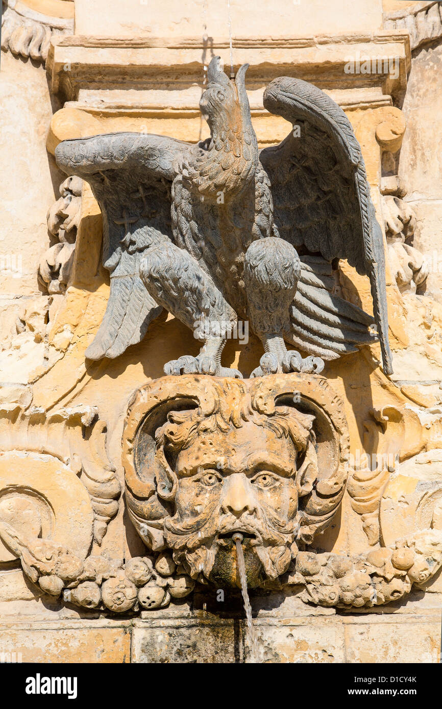 Ornate sandstone fountain, located in St George's Square, Misrah San George or Palace Square, in Valletta. - Stock Image