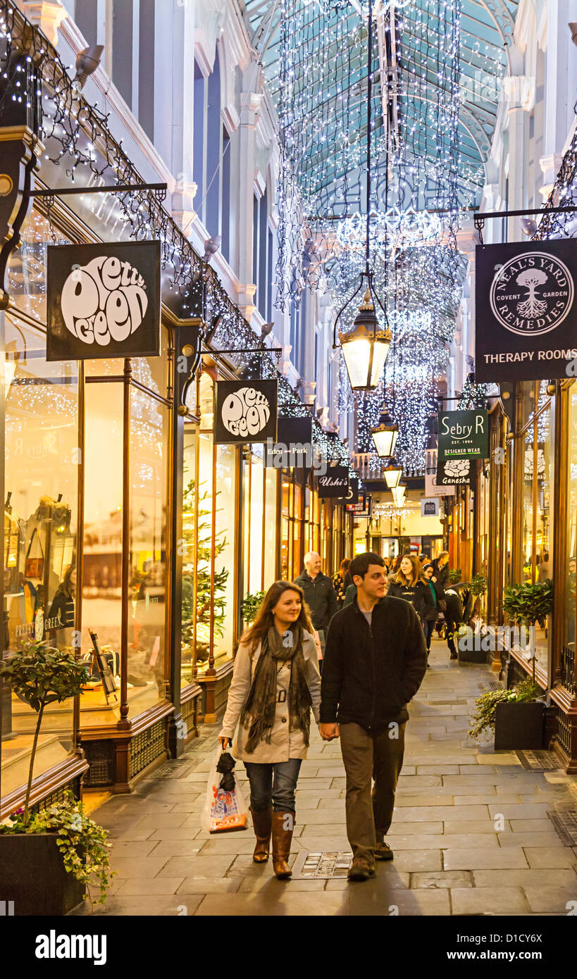Christmas shoppers in one of Cardiff's Victorian shopping arcades, Wales, UK - Stock Image