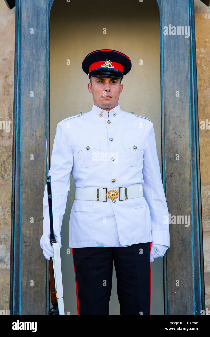 Malta, Europe. A guard in Summer military uniform outside the Presidential Palace in Valletta' - Stock Image