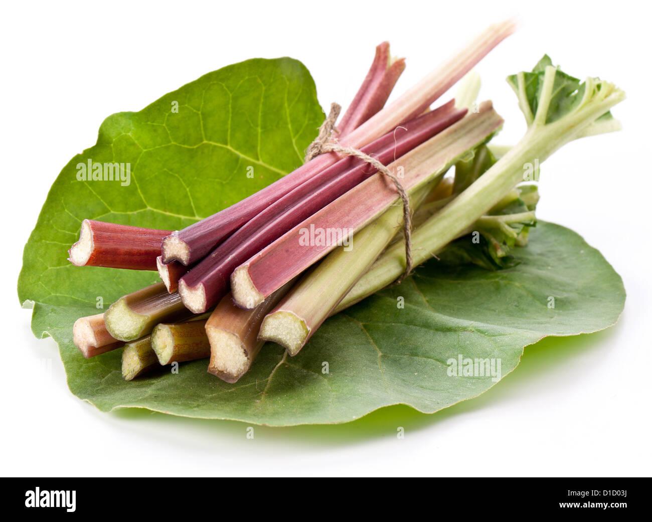 Rhubarb stalks on a white background. - Stock Image