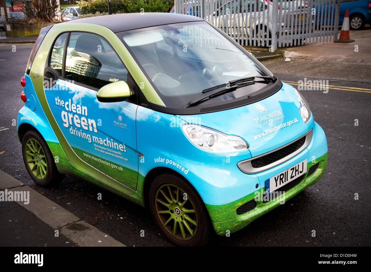 Electric vehicle used around the city by officers of Manchester City Council, England, UK. - Stock Image