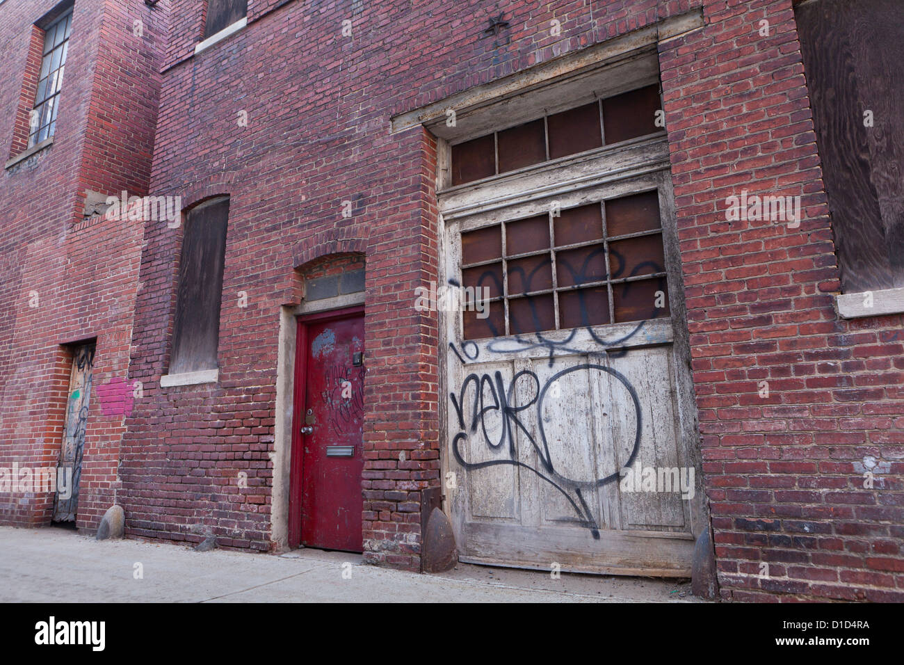 Old garage door of brick building - Stock Image