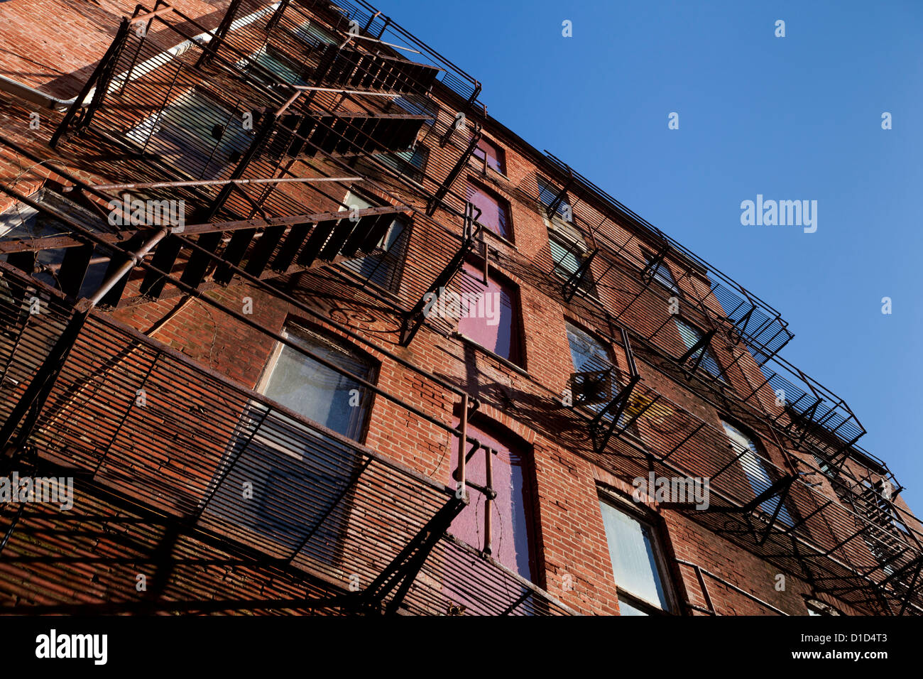 Fire Escape Stairs On An Old Brick Apartment Building