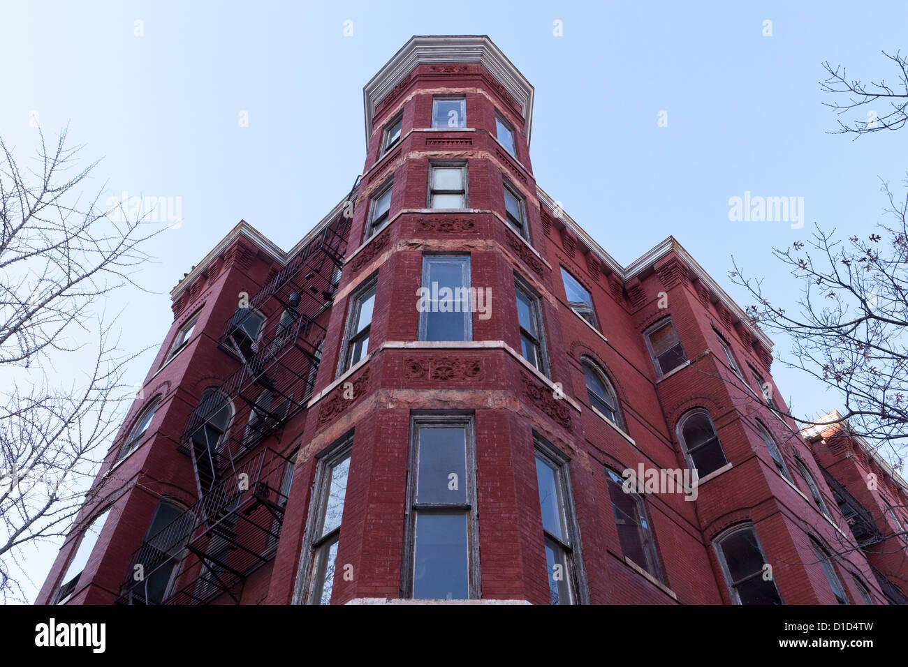 Corner turret of brick building - Stock Image