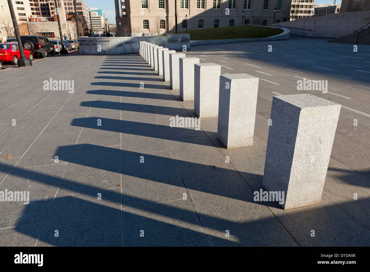 Protective bollards in front of US government building (stone safety barrier posts) - Washington, DC USA - Stock Image