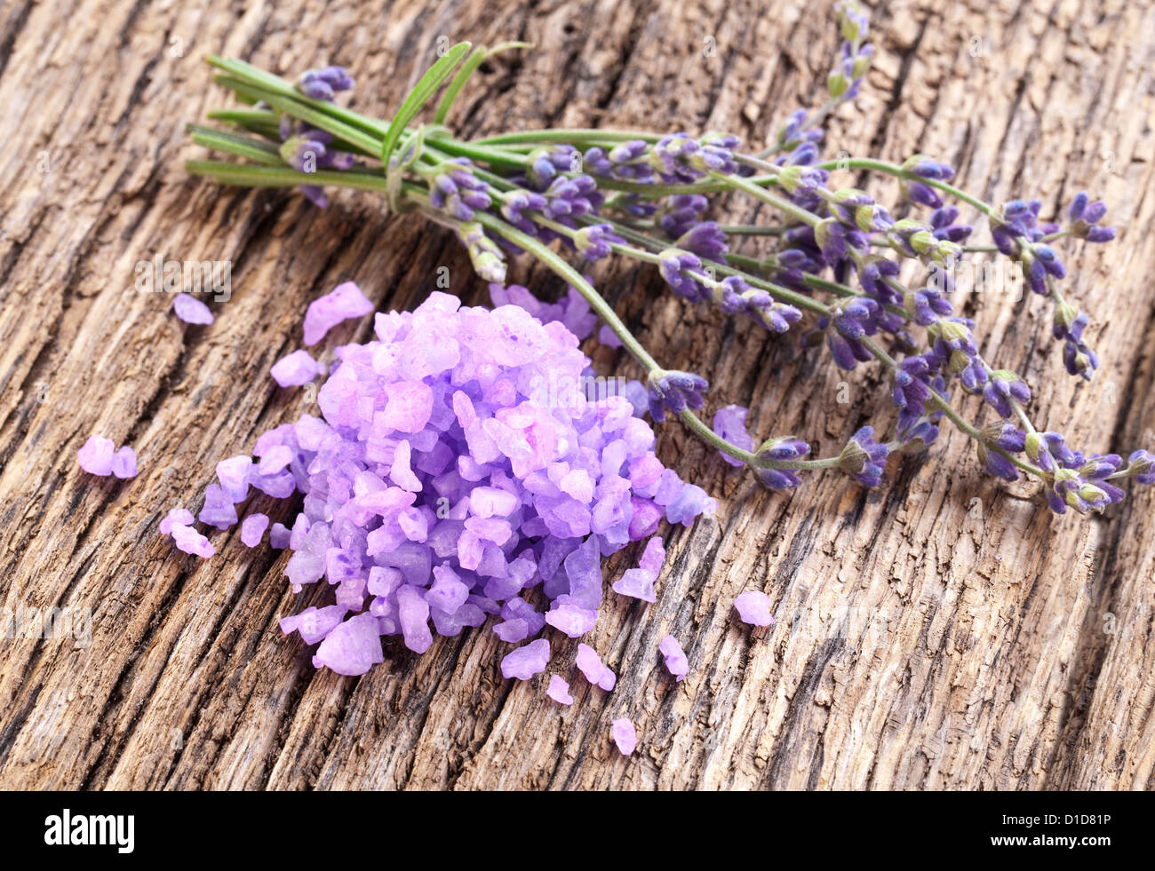 Bunch of lavender, and sea salt on a wooden table. - Stock Image