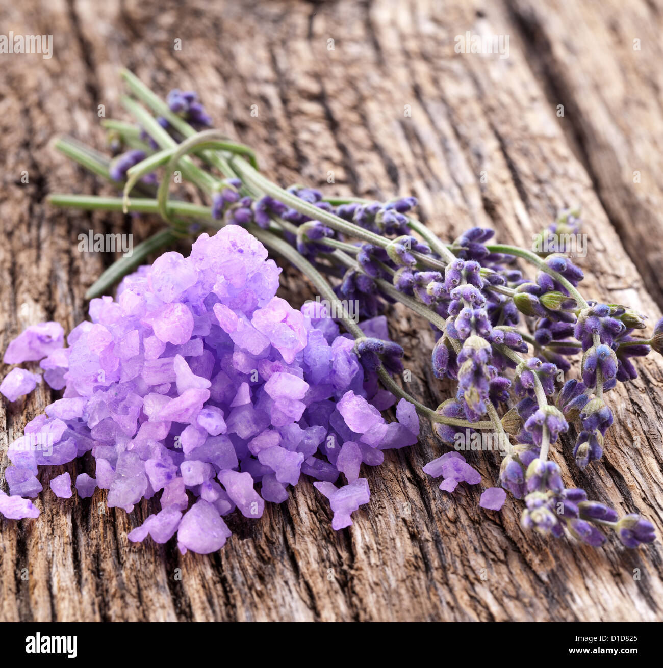 Bunch of lavender, and sea salt on a wooden table. Stock Photo