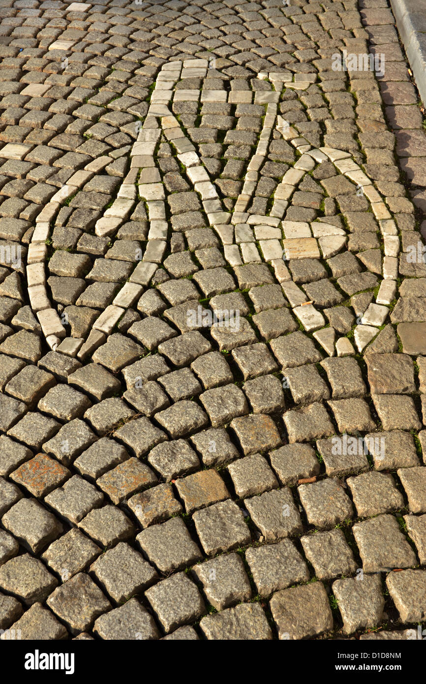 bicycle lane built into the stones on a cobblestone street in Maastricht's old city - Stock Image