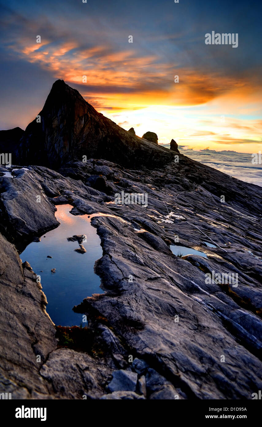 Mount Kinabalu, near Low's Peak, about 3900m. This is sunrise. - Stock Image