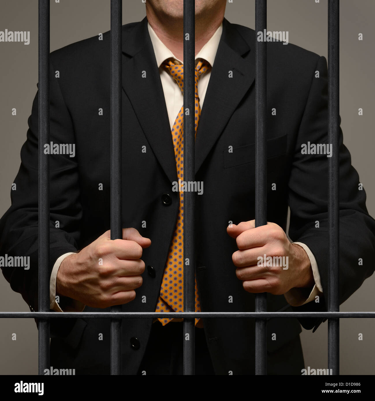 Jailed Business Man Behind Prison Bars. - Stock Image