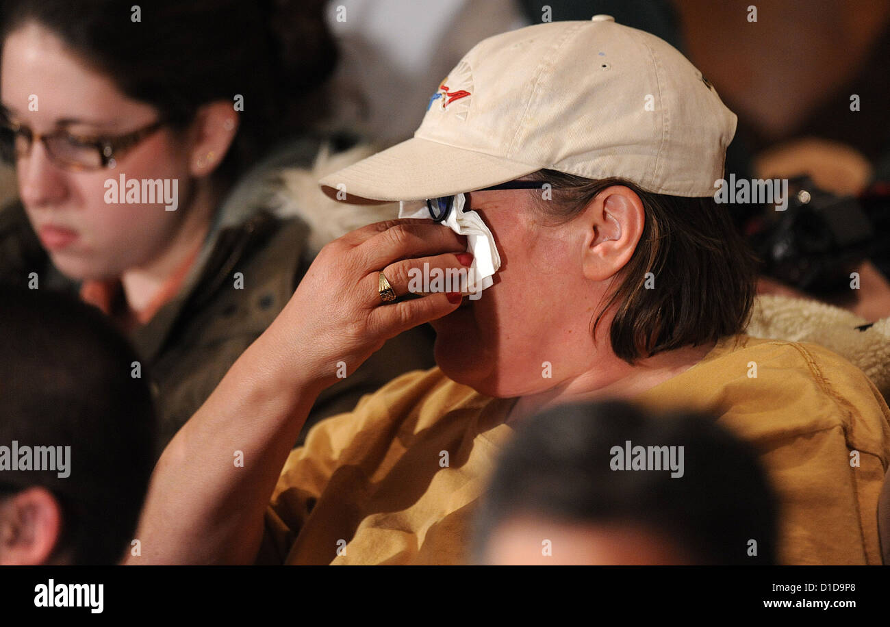 A women cries before United States President Barack Obama speaks at an interfaith vigil for families of the victims - Stock Image