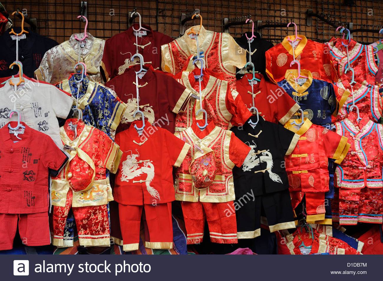 Bangkok Thailand Chinatown, stall selling traditional Chinese childrens clothing. - Stock Image