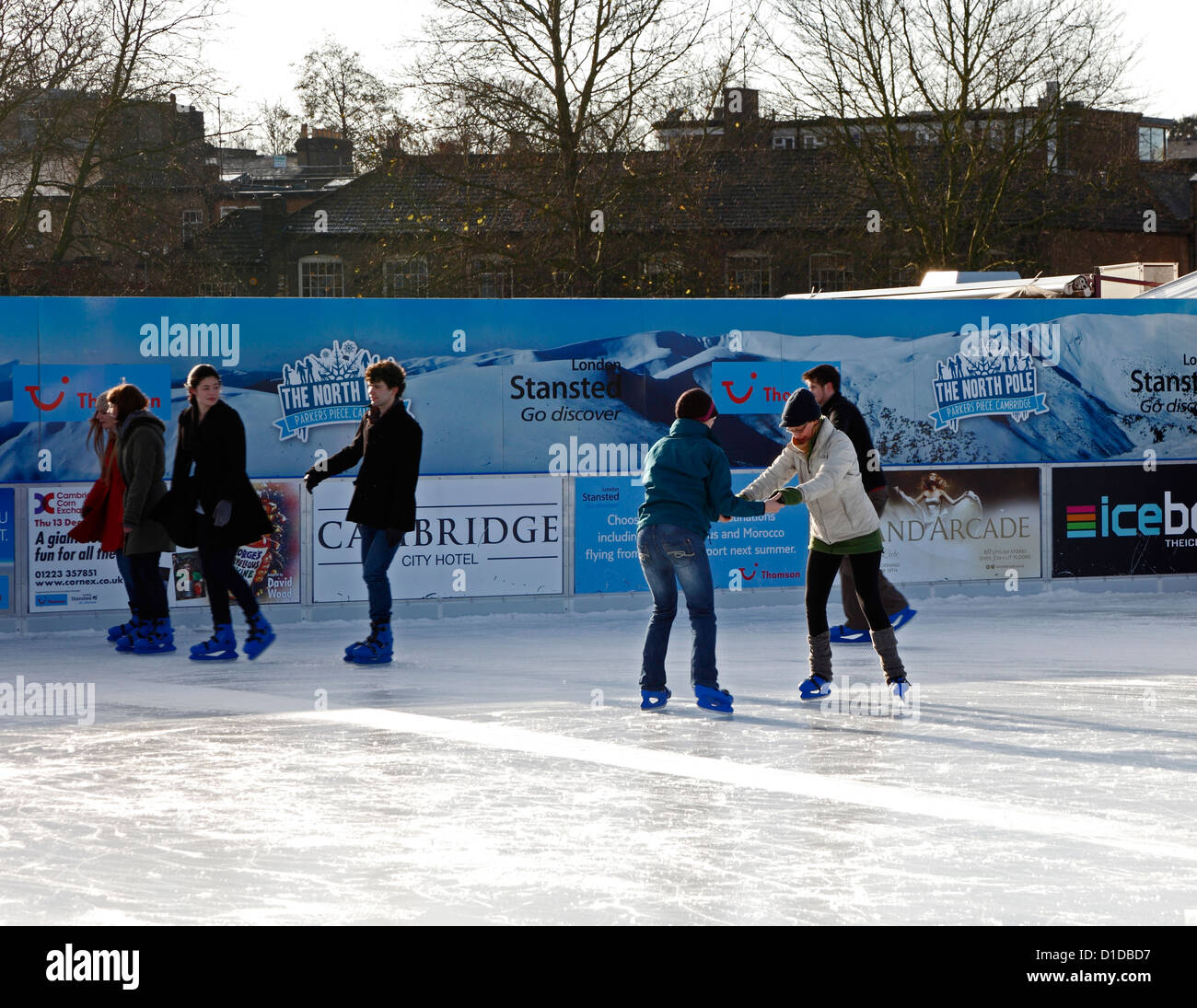 Learning to ice skate on temporary mobile ice rink on Parkers Piece Cambridge England - Stock Image