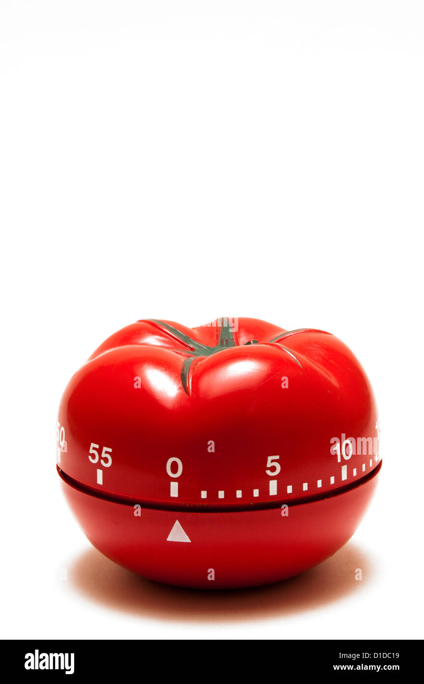 A kitchen timer in the shape of a tomato. - Stock Image