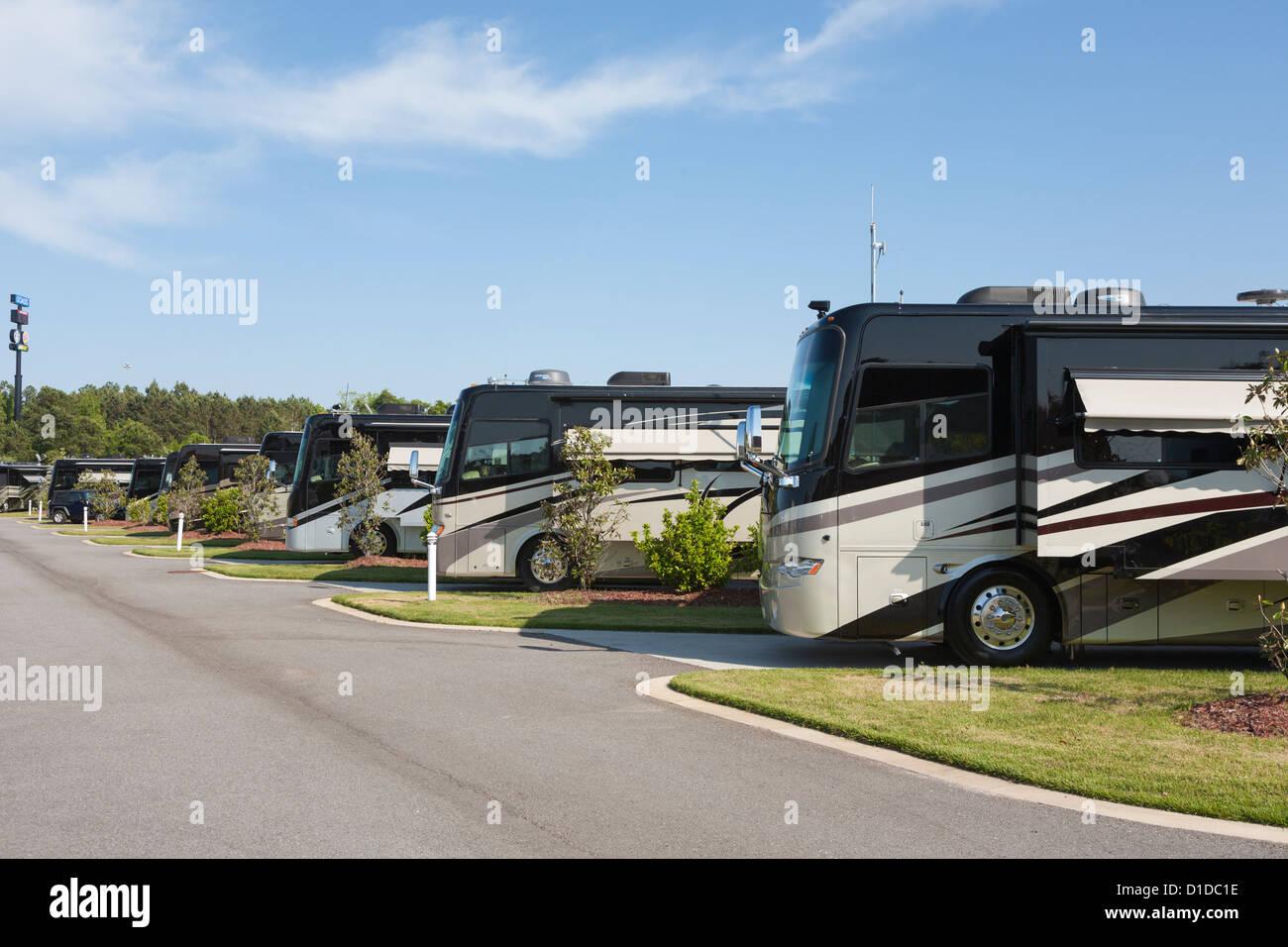 Luxury motor coaches parked at RV resort in Brunswick, Georgia - Stock Image