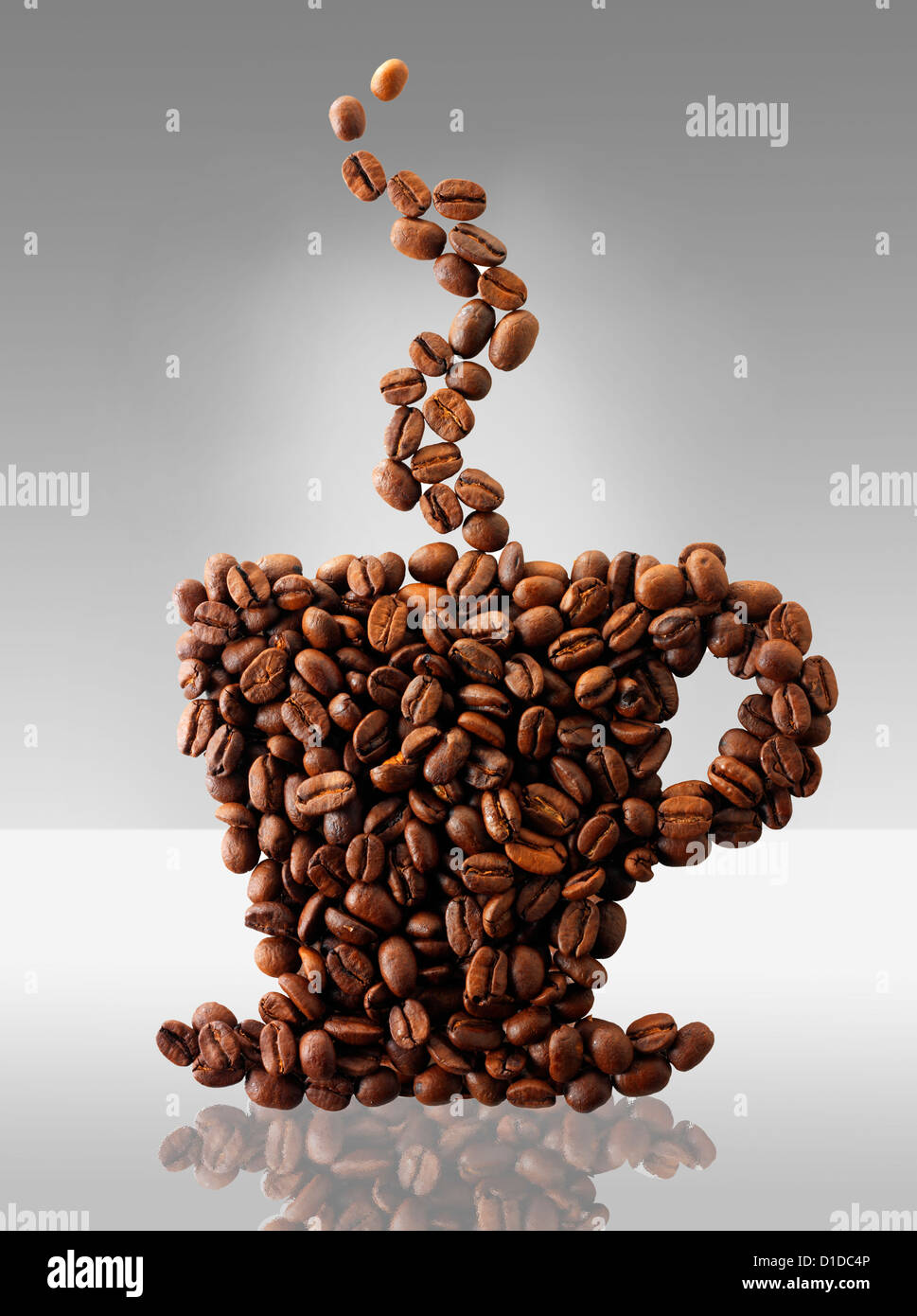 Coffee beans in the shape of a coffee cup. Stock Photo - Stock Image