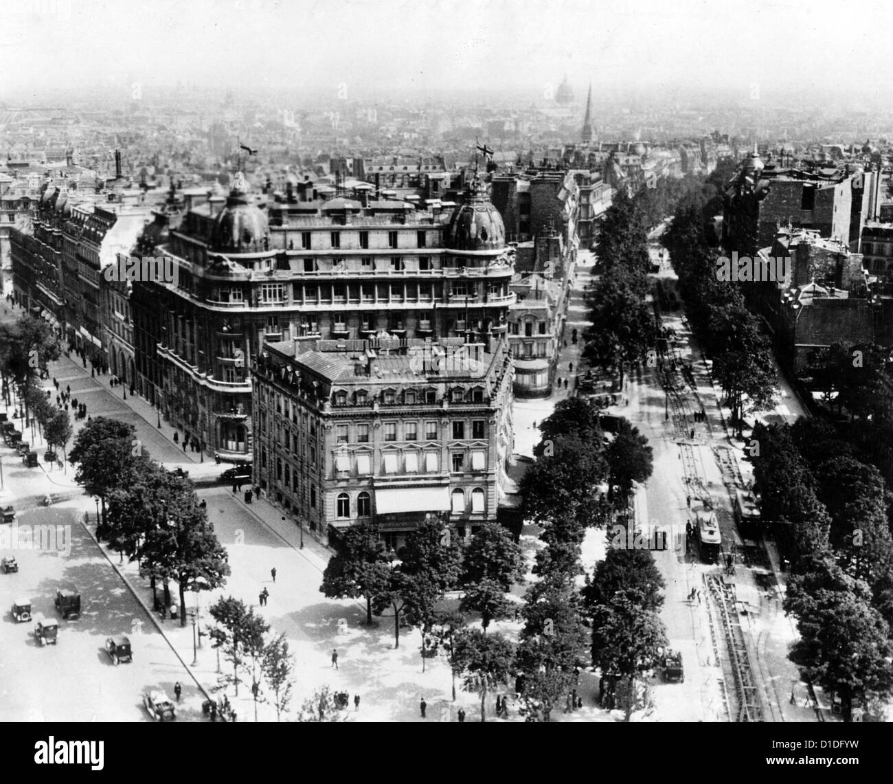 View of Avenue Marceau (r) and Champs Elysees (l) from Arc de Triomphe on Place de l'Etoile (today's Place - Stock Image