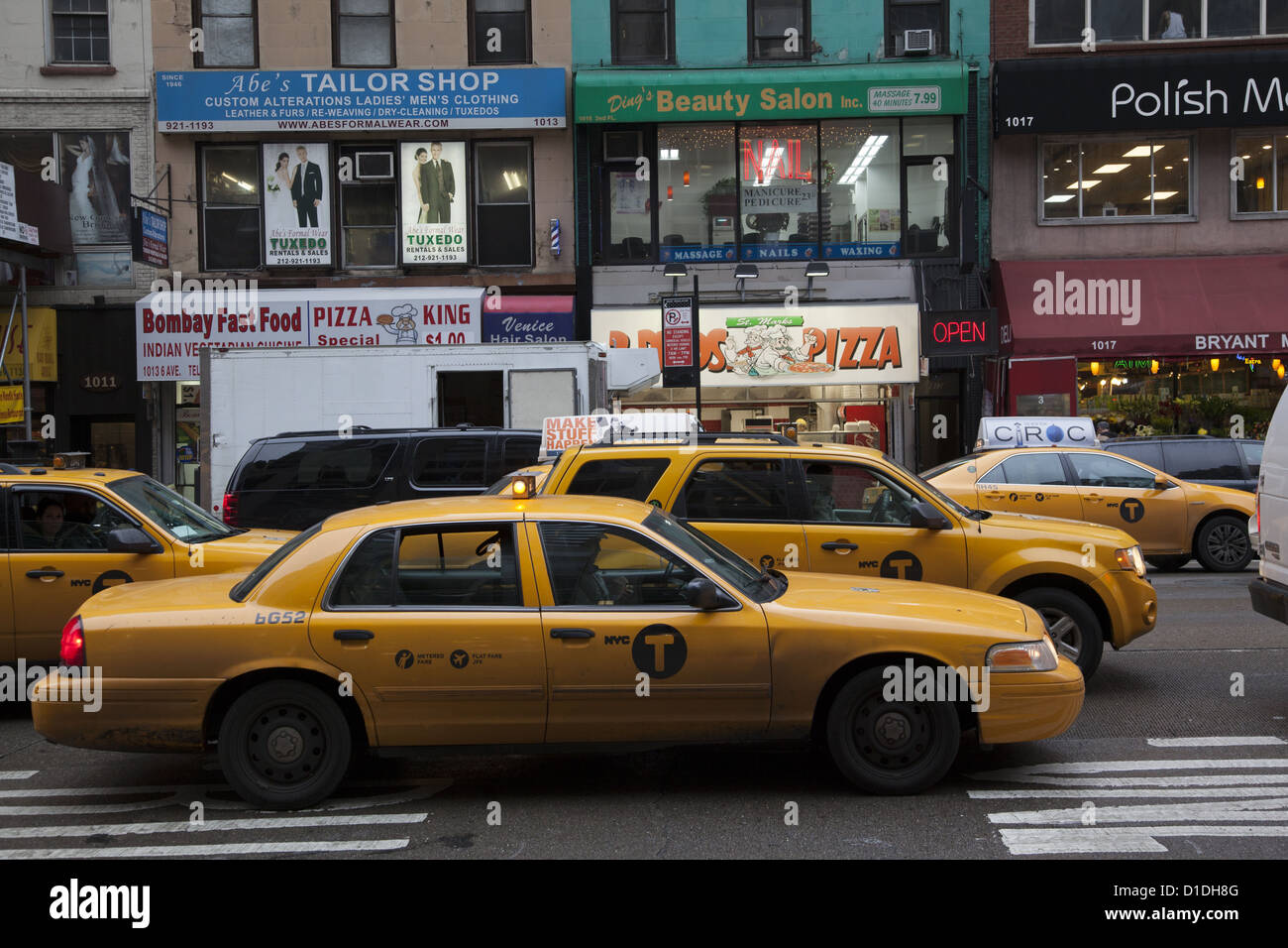 Midtown Manhattan is always dominated by cabs and congestion. - Stock Image