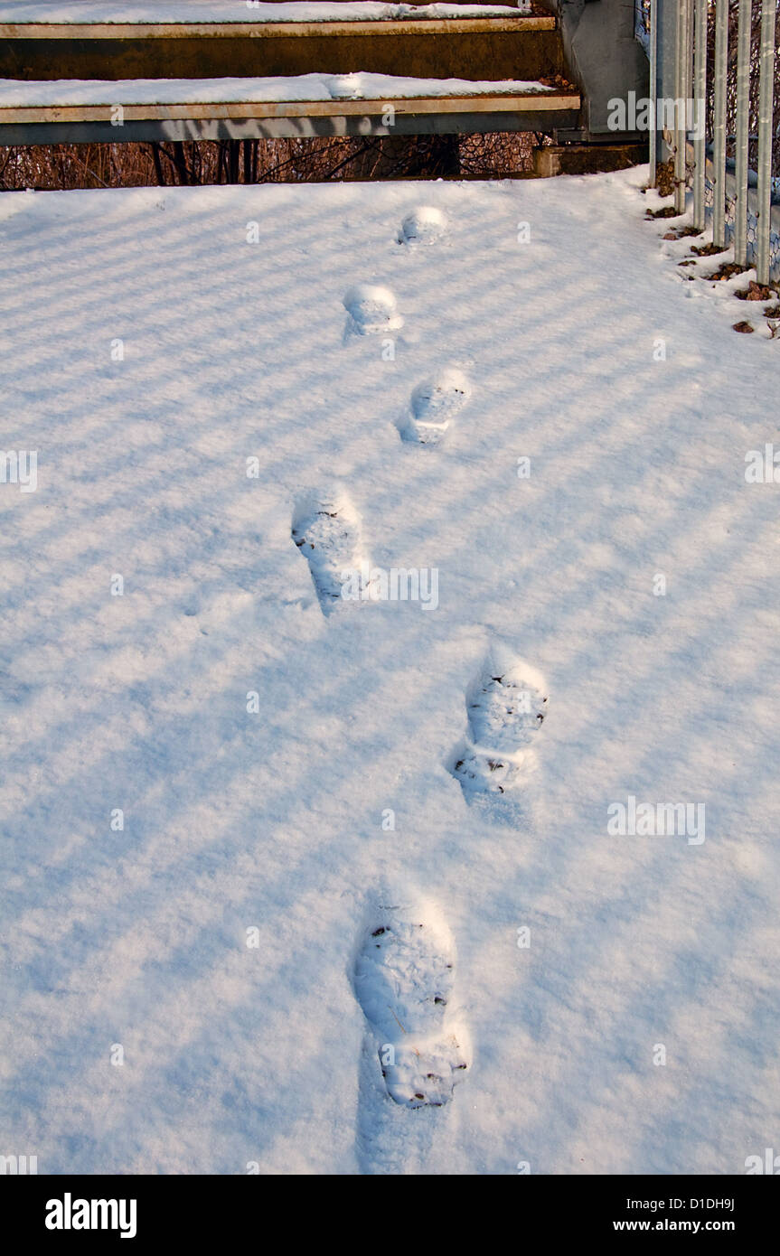 Footprints in the snow - Stock Image