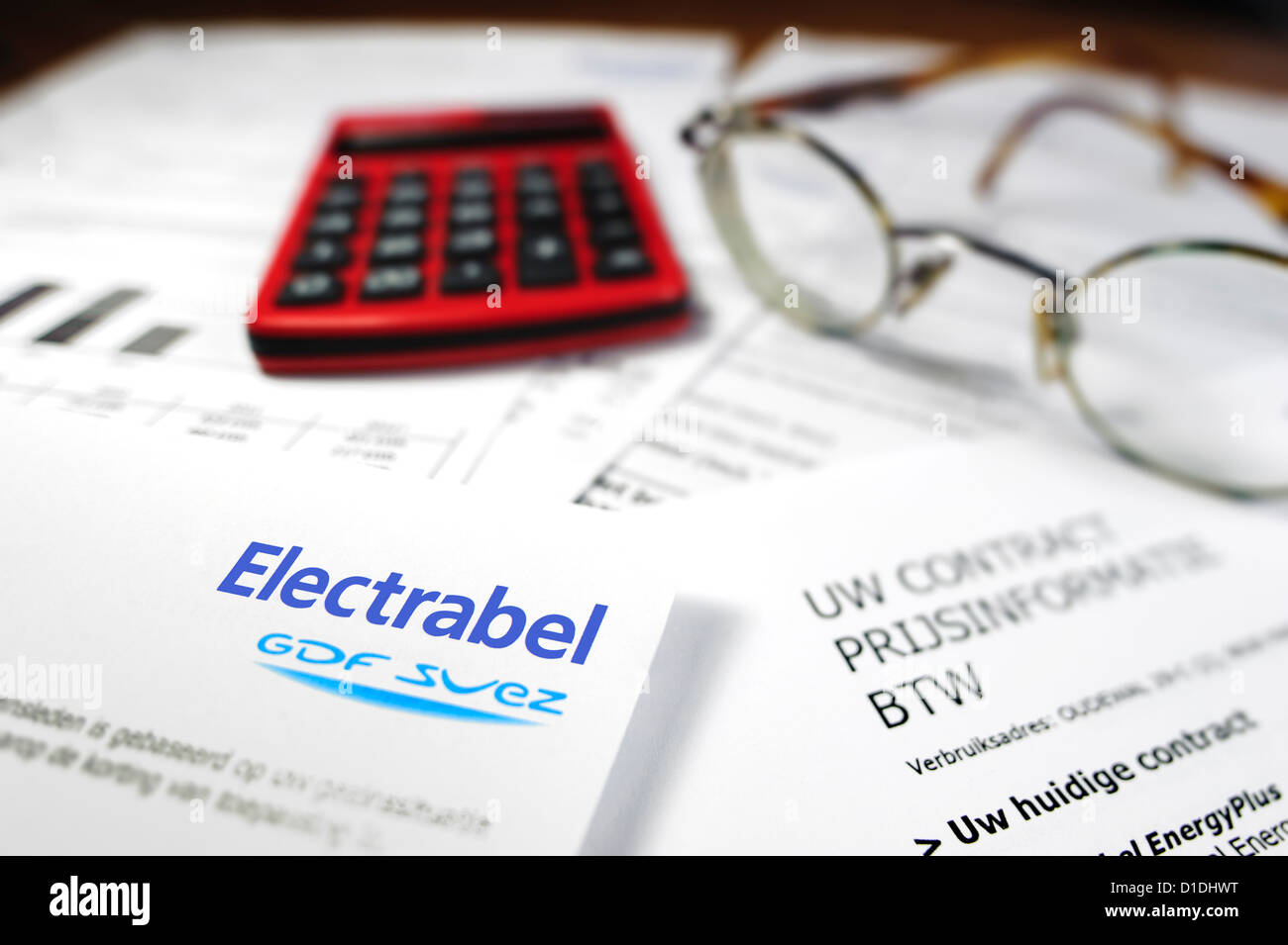 Calculator and Flemish invoice and contract of Electrabel, Belgian energy corporation, supplier of electricity and - Stock Image
