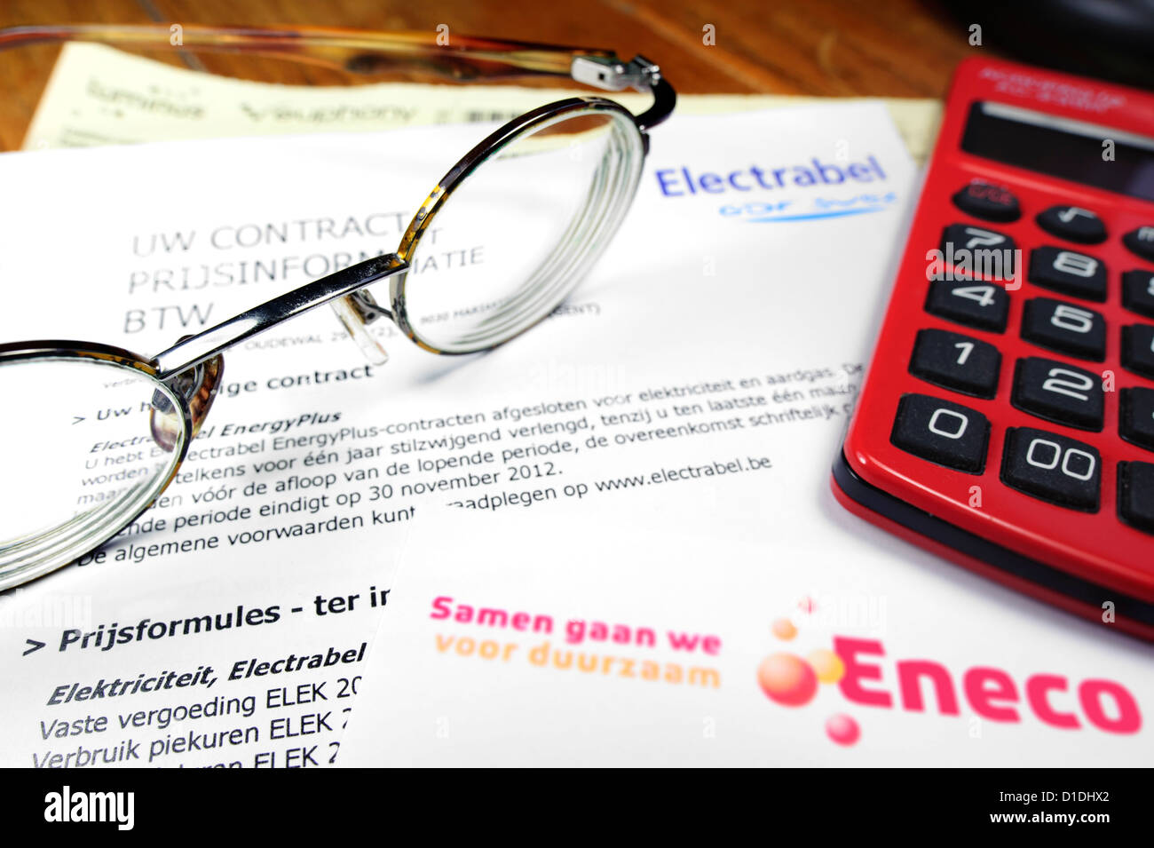 Calculator and Flemish invoices of Eneco and Electrabel, Belgian energy corporations, suppliers of electricity and Stock Photo