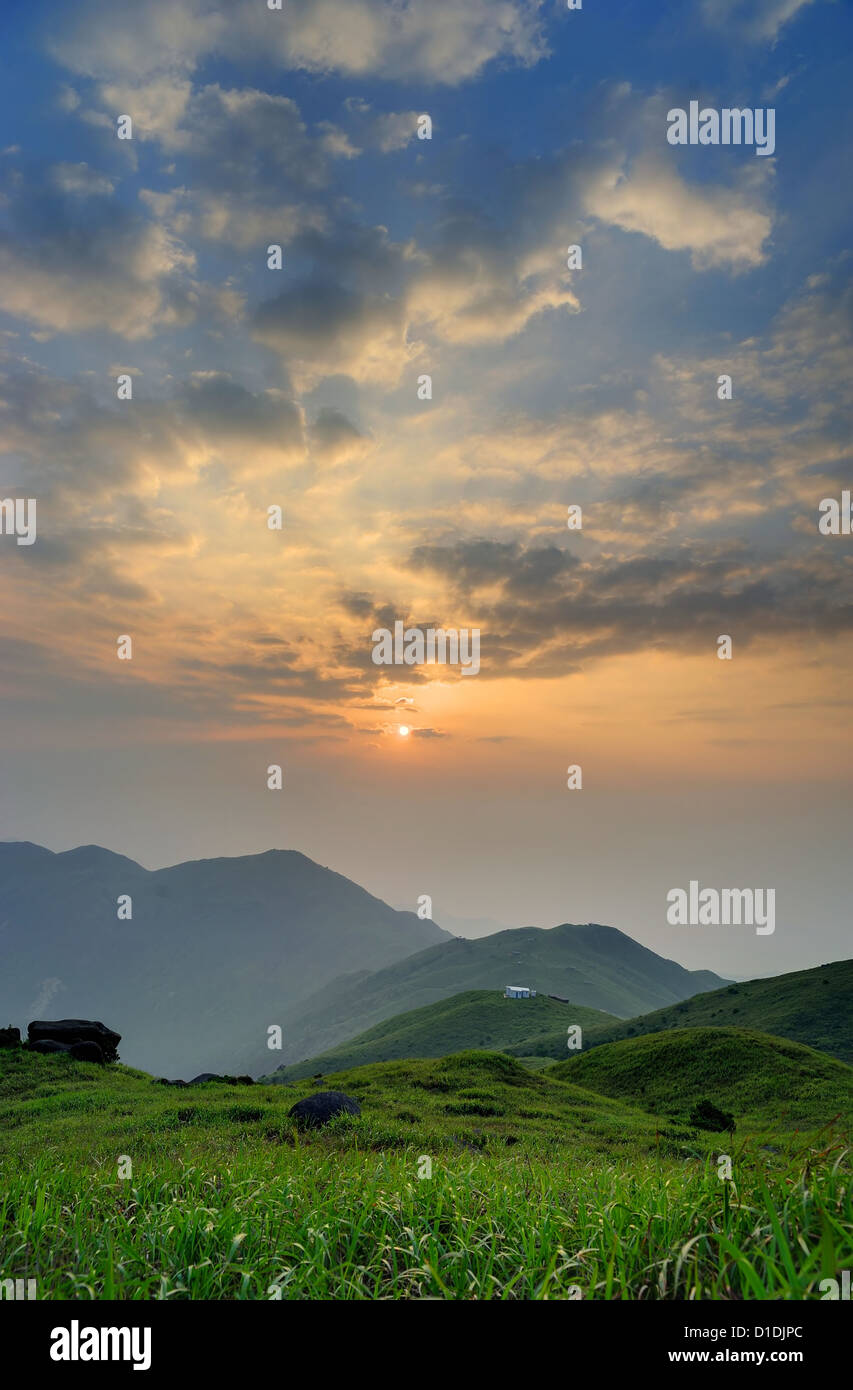 Sunrise from the Sunset Peak, Hong Kong. The grass in the front.  - Stock Image