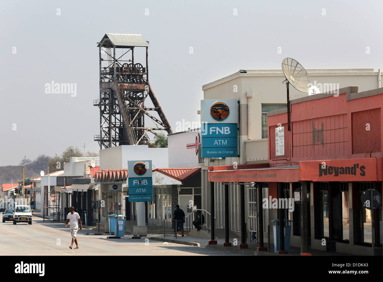 Tsumeb, Namibia. President street with shaft tower of the former copper mine - Stock Image