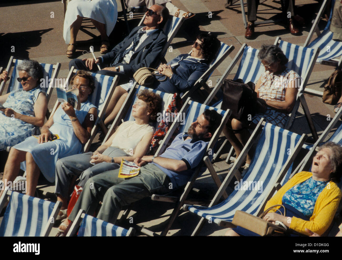 Old people asleep in deck-chairs on a sunny day by the English Stock ...