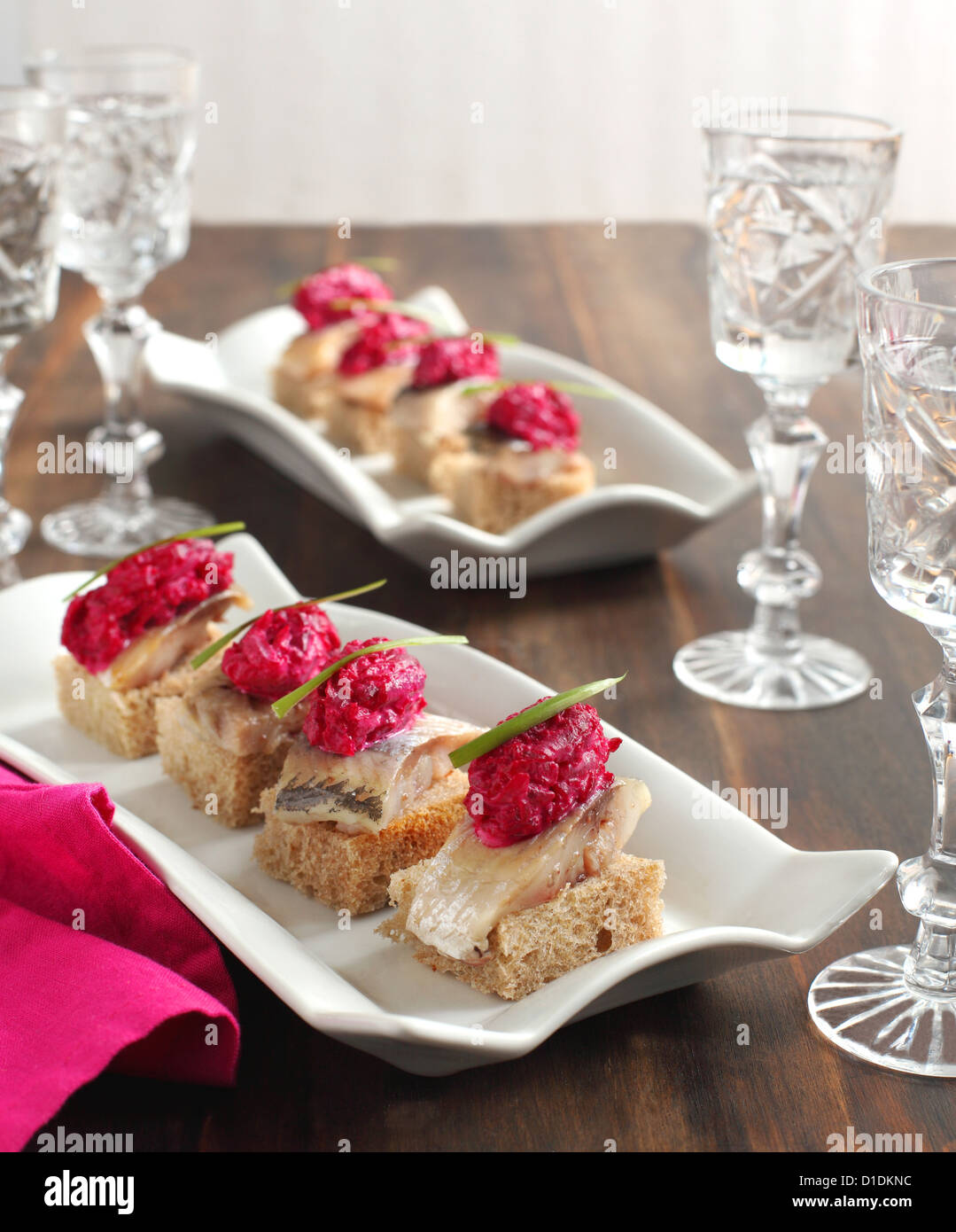 Canapes with herring fillets and beets - Stock Image