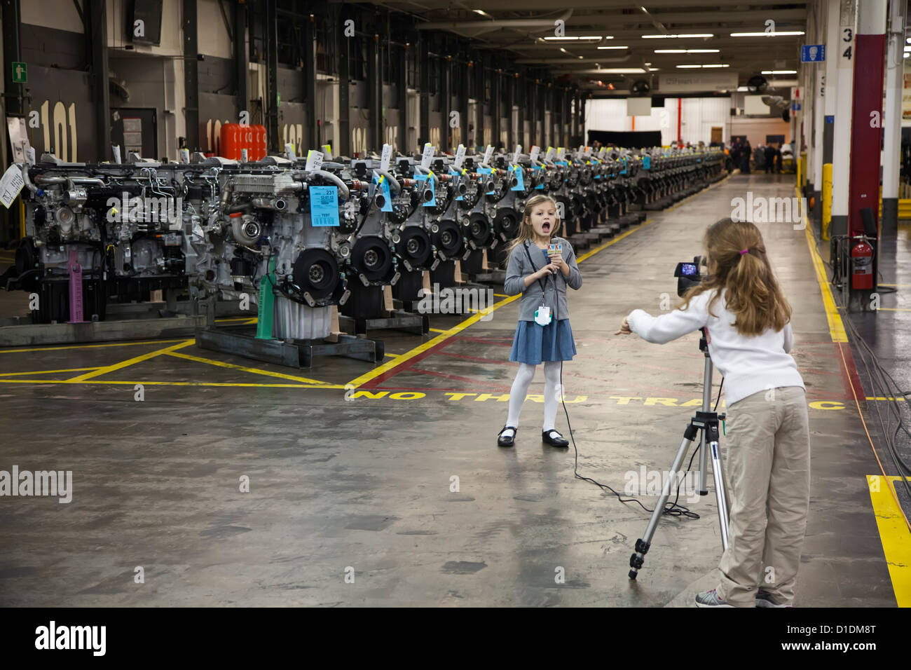 Seven-year-old girls report for Kid Witness News during a visit by President Barack Obama to a Detroit Diesel factory. - Stock Image