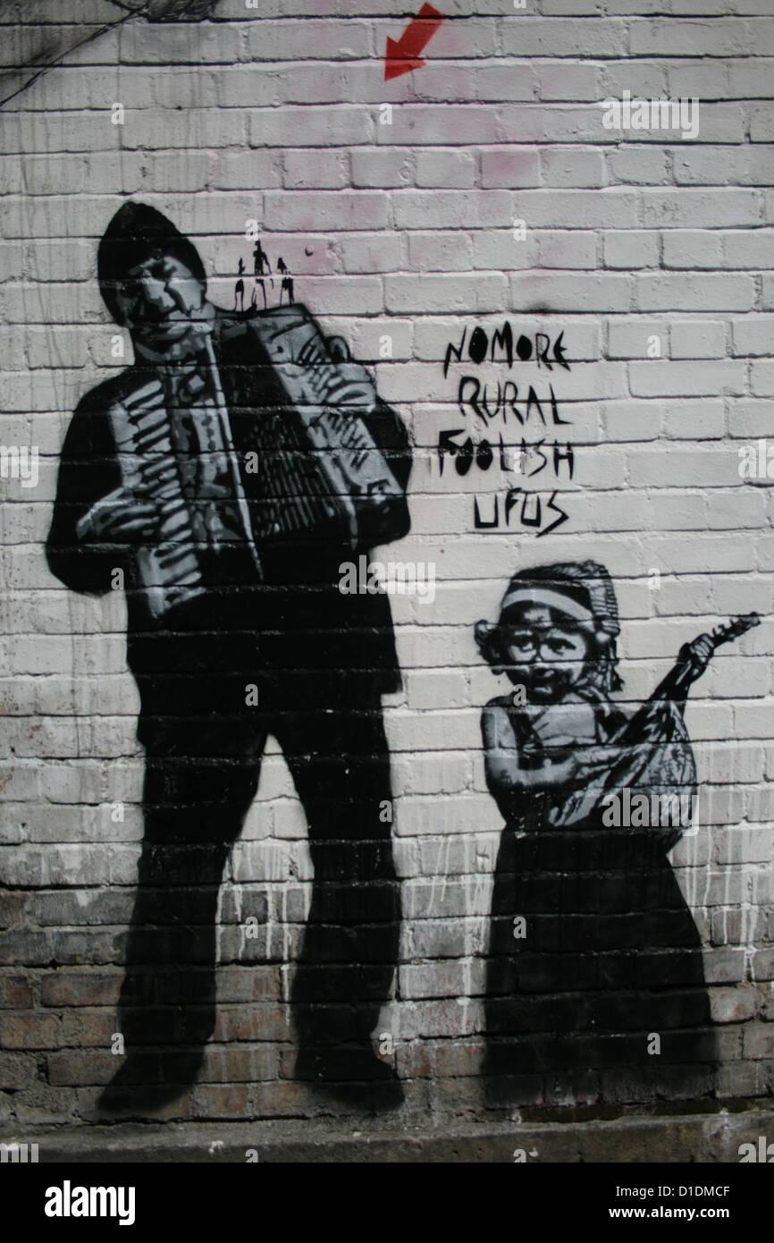 Stencil graffiti artwork by Jef Aérosol near Brick Lane, East London - Stock Image