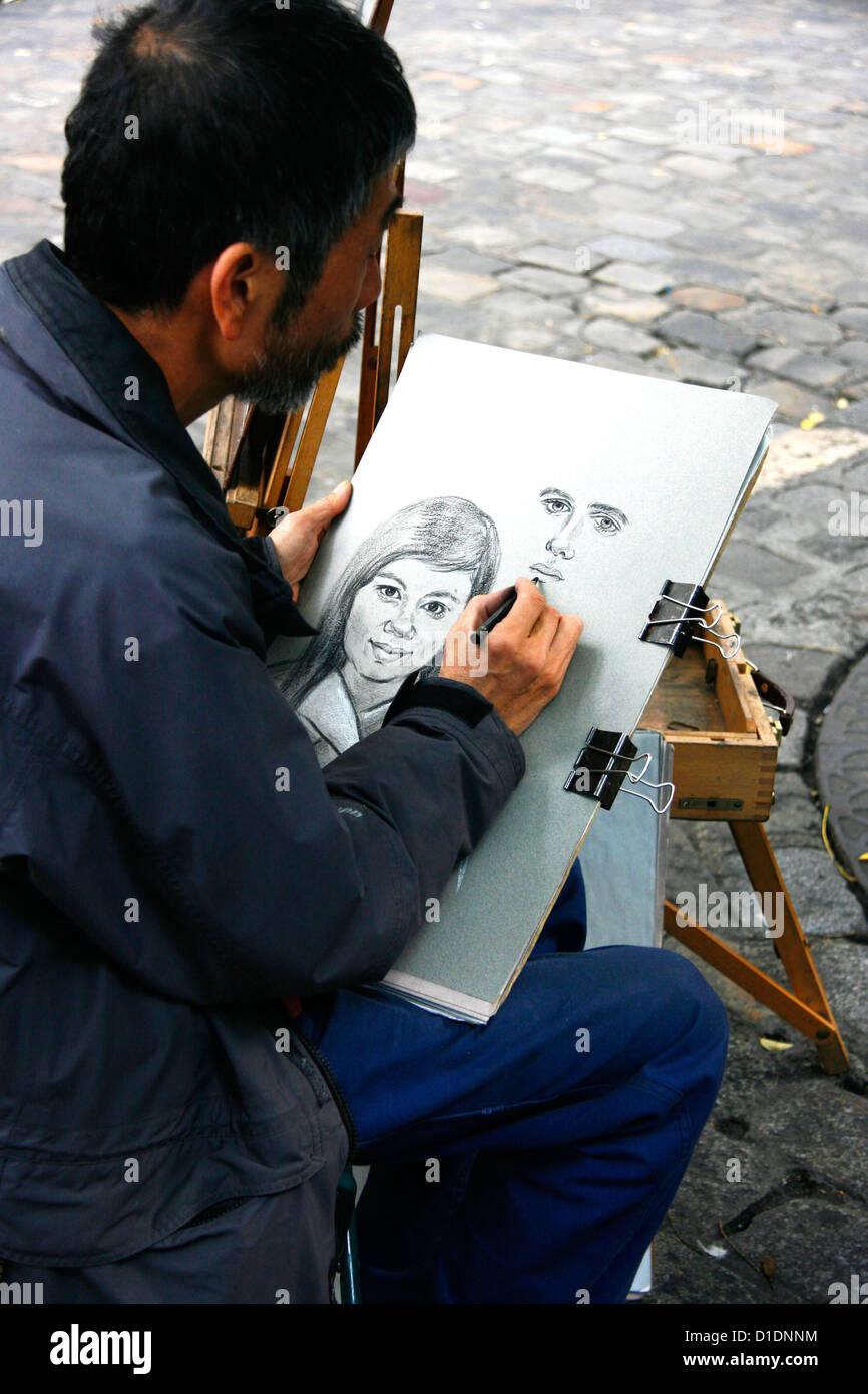 Street Artist Drawing Portrait Of A Couple Place Du Tertre
