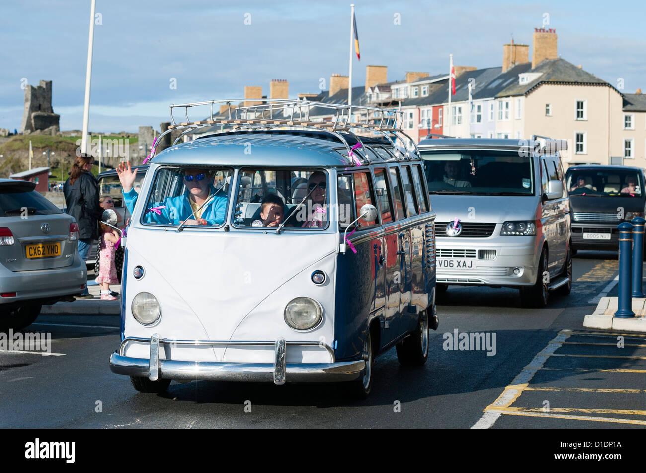 A classic VW Volkswagen Samba campervan, driving along the promenade at  Aberystwyth Wales UK - Stock Image