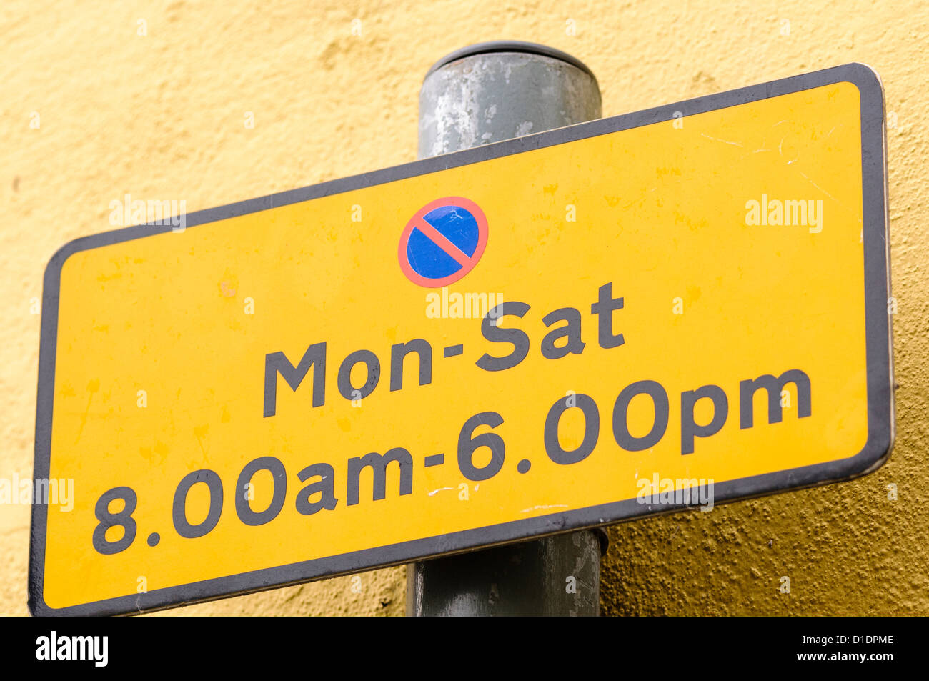 Restricted parking sign, showing parking is not permitted Monday to Saturday between 8am and 6pm - Stock Image