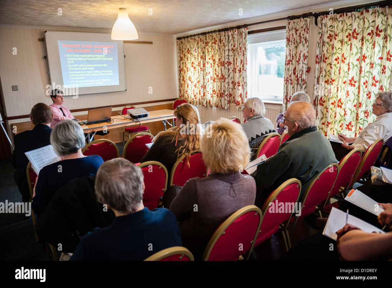 Giving advice on Housing Benefit changes to a members of a housing association at the annual Tenant Conference - Stock Image