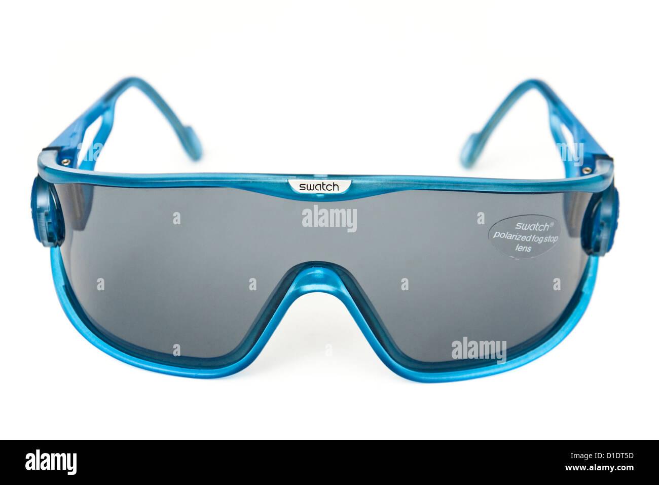 Swatch designer ski goggles / sunglasses with polarized fog-stop lenses and tilting frame adjustment - Stock Image